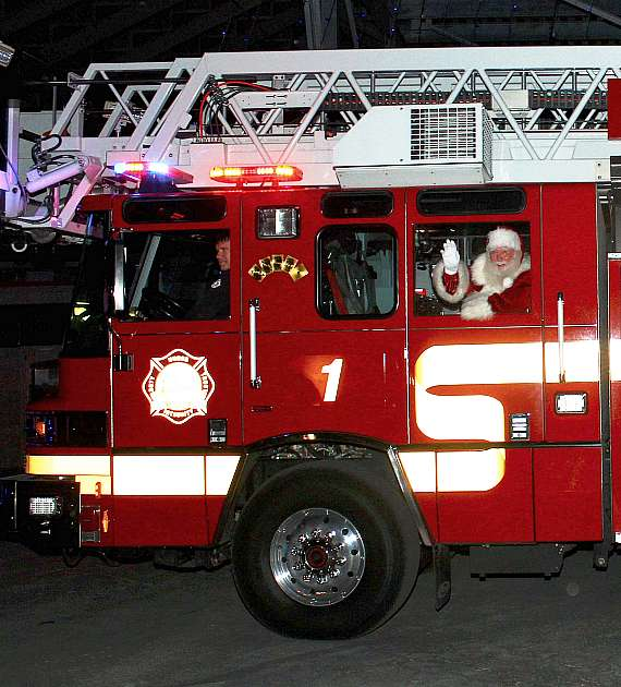 Santa Claus driven into the park by Las Vegas Fire and Rescue Department's Engine 1 Firetruck