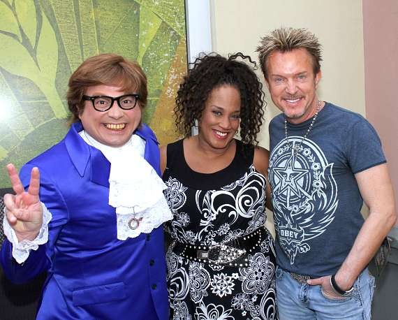 Celebrity Impersonator John Di Domenico as Austin Powers, Singer Michelle Johnson, and Chris Phillips of Zowie Bowie