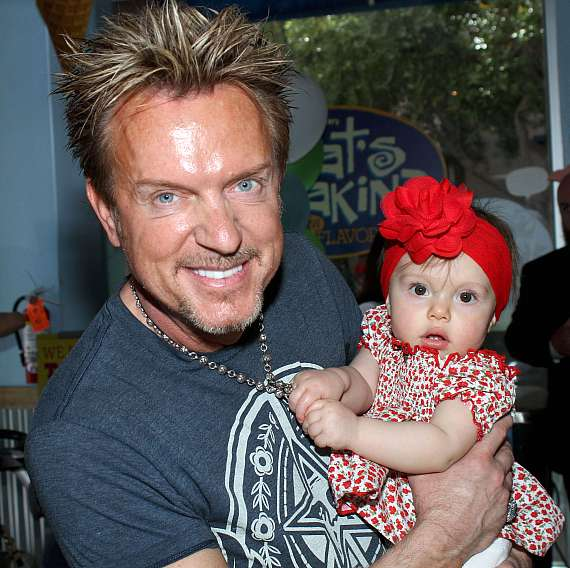 Singer Chris Phillips of Zowie Bowie with daughter