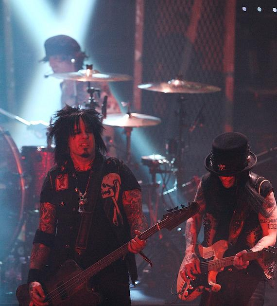 Drummer Tommy Lee, bass player Nikki Sixx and guitarist Mick Mars