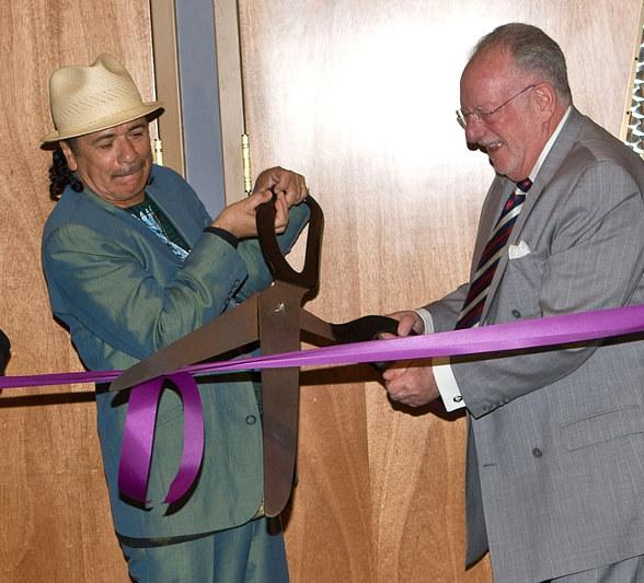 Carlos Santana and Oscar Goodman cut the ribbon at The Joint