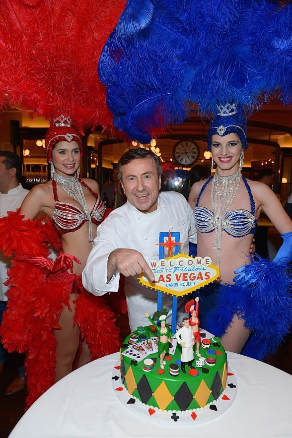 "Chef Daniel Boulud with his custom Welcome ""Back"" to Las Vegas cake by Buddy ""The Cake Boss"" Valastro, backed by showgirls of course!"