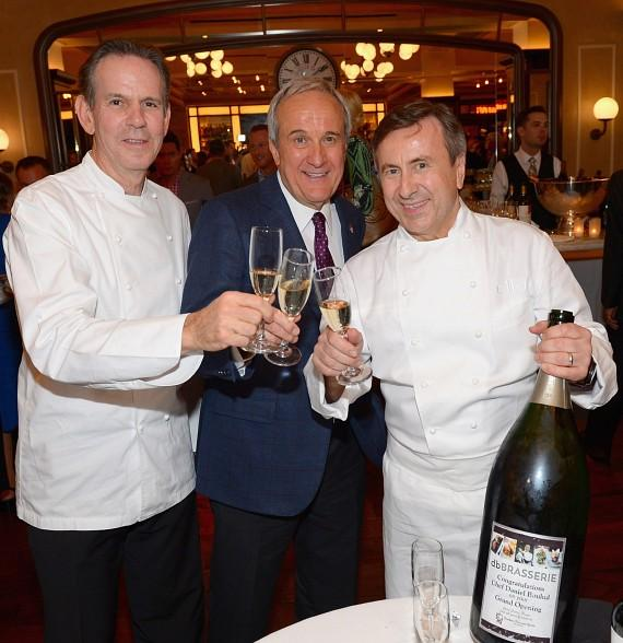 Chef Thomas Keller, Larry Ruvo and Daniel Boulud toast from the celebratory bottle of champagne from Southern Wine and Spirits