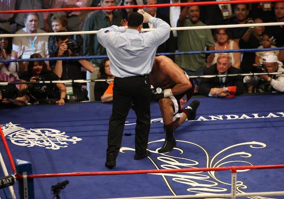 Jameel McCline fails to get up as referee Tony Weeks counts to ten