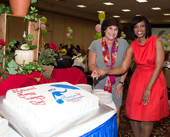 Lexy Lionel and Deborah Tillman with cake