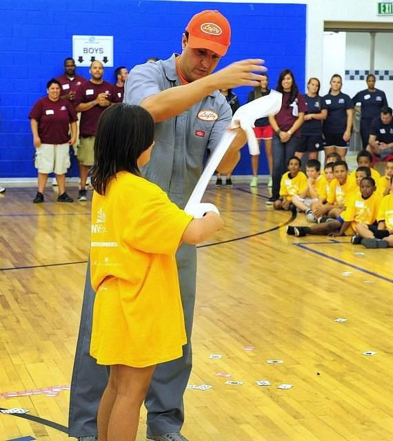 """Douglas """"Lefty"""" Leferovich performs magic with a volunteer from the audience"""
