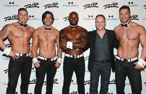 Tyson Beckford (C) and Michael Caprio (2nd from L) poses for photos with Chippendales at the Rio on May 1, 2015