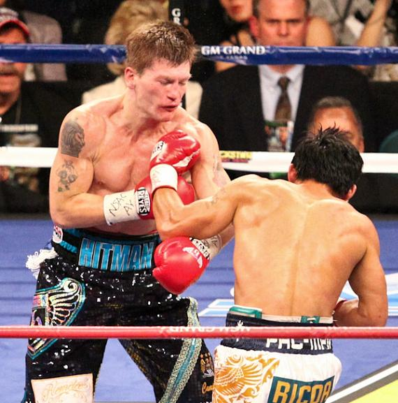 A huge left hook by Pacquiao sends Hatton to the canvas