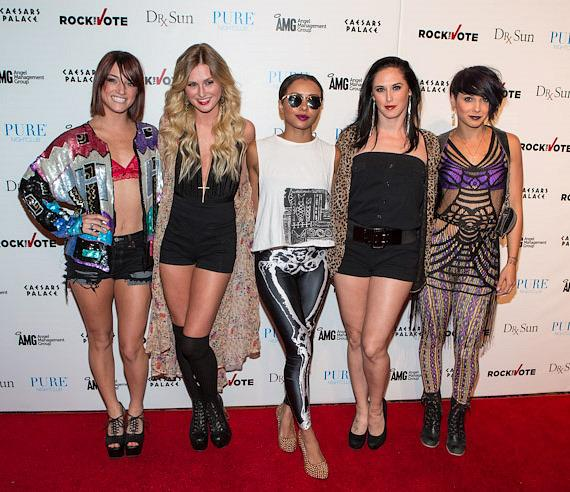 Kat Graham with dancers on red carpet inside PURE Nightclub