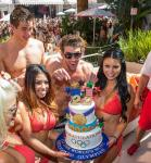 Michael Phelps with retirement cake and Encore Beach hotties