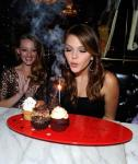 Actress Aimee Teegarden blows out the sparkler on her birthday cupcakes at Sugar Factory American Brasserie at Paris Las Vegas