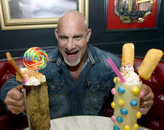 Bill Goldberg with two Sugar Factory milkshakes