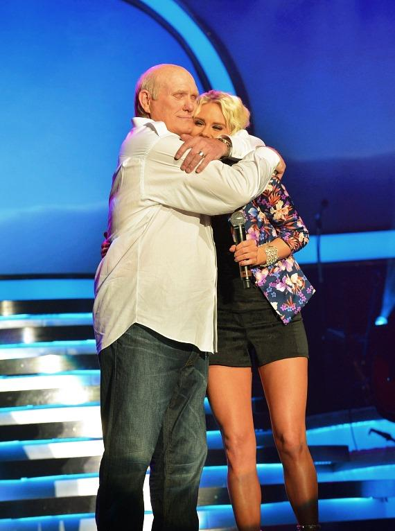 Terry Bradshaw (L) and recording artist Rachel Bradshaw perform during the 'Terry Bradshaw: America's Favorite Dumb Blonde... A Life in Four Quarters' show premier at The Mirage Hotel & Casino