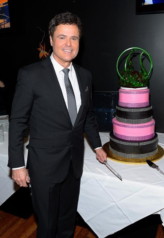 Donny Osmond poses with cake that celebrates their 1000th performance at the Flamingo Las Vegas