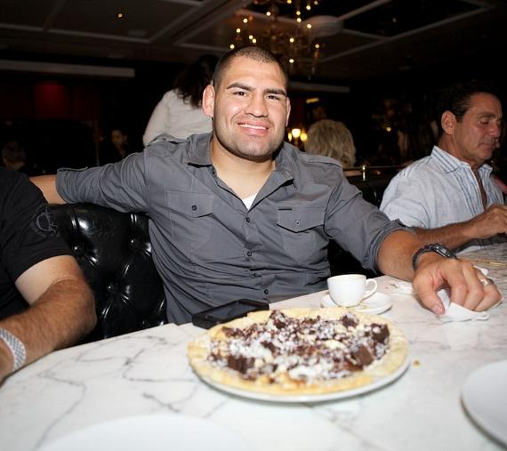 """Cain Velasquez with a decadent """"Chocolate, Chocolate, Chocolate"""" sweet dessert pizza at Sugar Factory American Brasserie"""