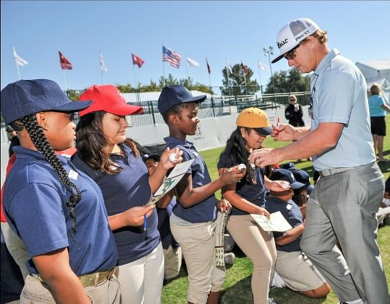 Charley Hoffman autographs golf balls for student