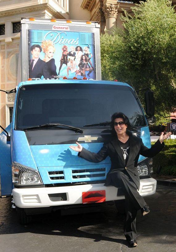 """Frank Marino sits on his """"drag"""" mobile billboard, with eyelashes on the headlights and a lipstick license plate."""