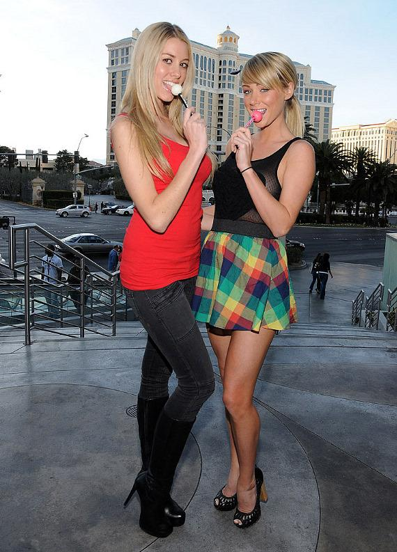 Heather Rae Young and Sara Underwood pose outside the Las Vegas Strip With Sugar Factory's Couture Pops on Super Sunday