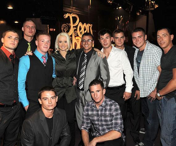 """Holly Madison (3rd from L) and Steve Davidovici (R) pose for photos with U.S. Marines at """"Peepshow"""" at Planet Hollywood Resort & Casino on July 18, 2011 in Las Vegas, Nevada."""