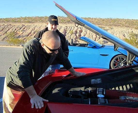 Andy Spinks and Dave Turin  check under the hood of a Ferrari 458 Italia