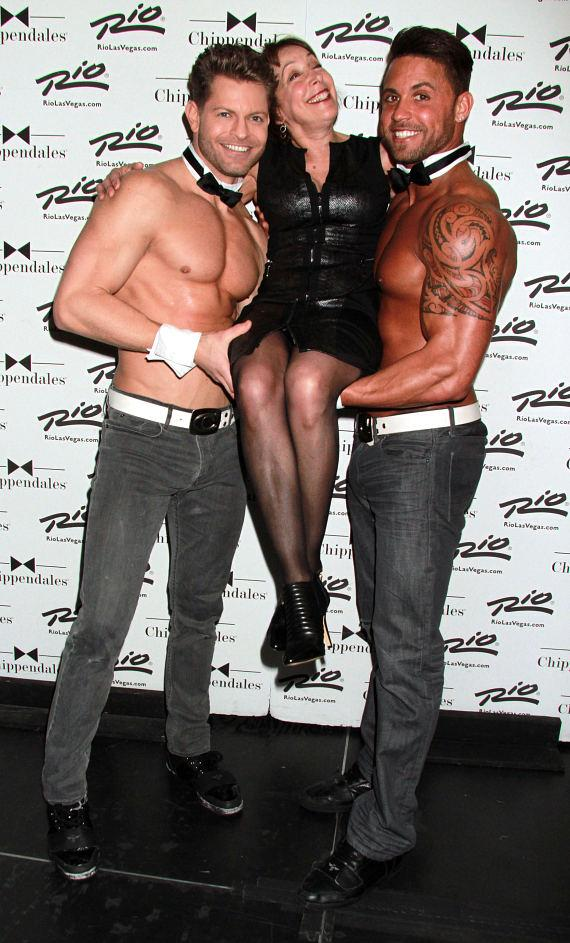 """Grease"" Actress Didi Conn poses with Chippendales dancers Jaymes Vaughan and Matt Marshall at Rio Las Vegas"