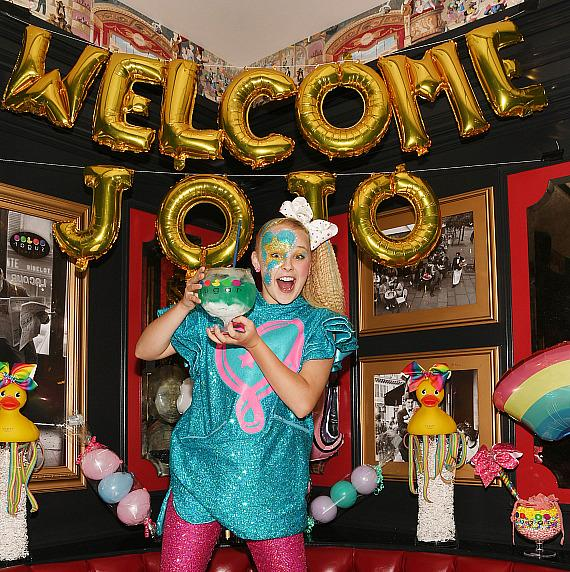 JoJo Siwa poses with non-alcoholic ocean blue goblet and JoJo themed decorations