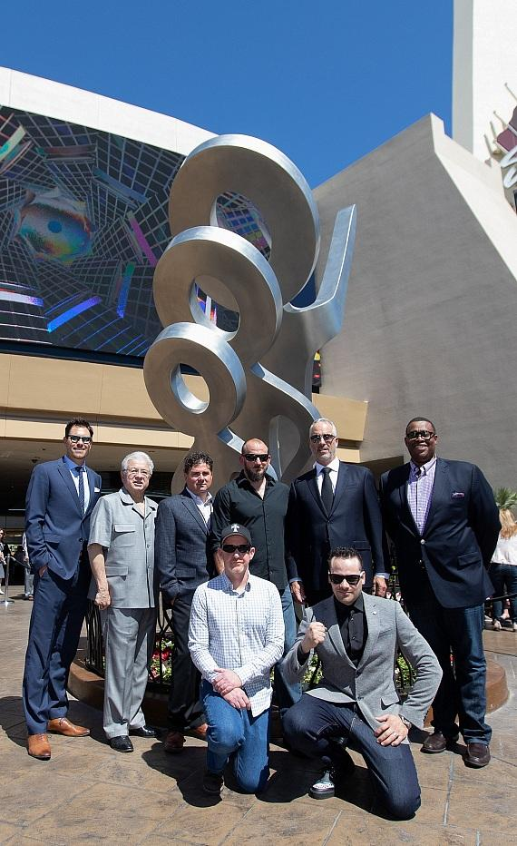 "Left to right, back row: John Barry, Kevin Barry Fine Art, City Councilman Bob Coffin, VP and GM of The STRAT Chris Fiumara, Artist Nick Stiley, Golden Entertainment Chairman, President and CEO Blake L. Sartini, City Councilman Cedric Crear; and front row, Artists James Talbert and Adin Fly, stand in front of ""LOOK!"""