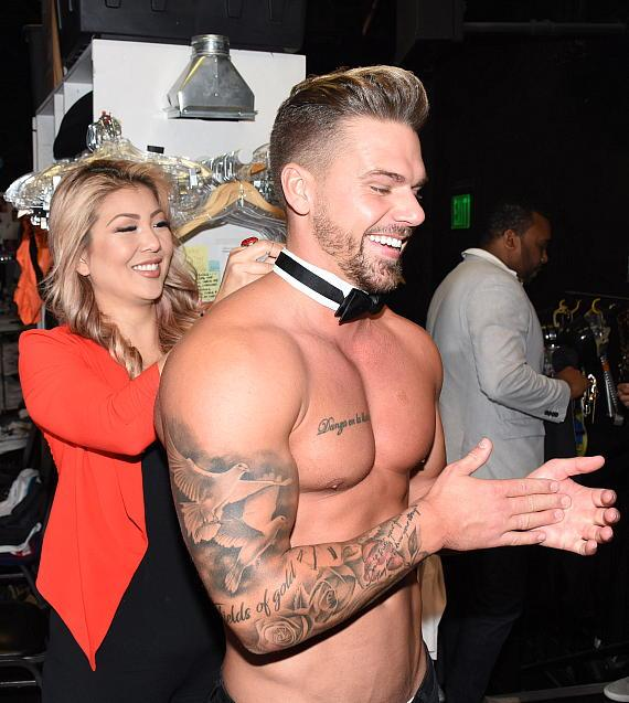 UK Fitness Model and MTV Personality Joss Mooney Models Chippendales' Iconic Cuffs and Collar Costume