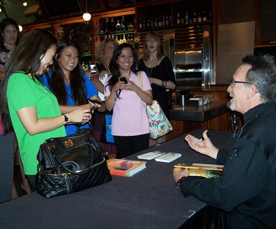 Chef Rick Moonen autographing books for LVHA members