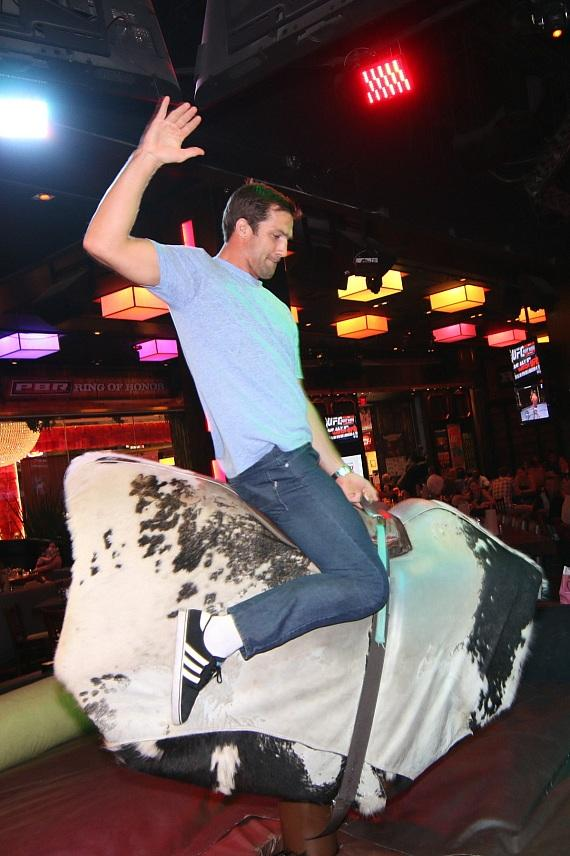 Luke Rockhold rides the bull at PBR Rock Bar