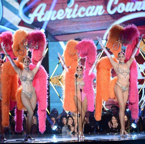 NASCAR driver Danica Patrick performs on stage with Jubilee! Showgirls at American Country Awards