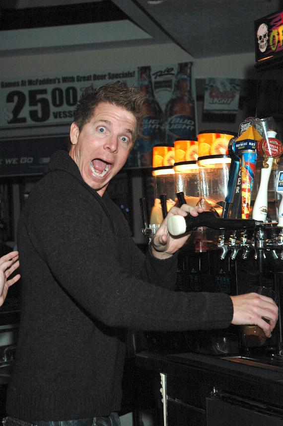 """Mark Long pouring a beer into McFadden's signature pint glass at """"The Goose is Loose"""" Canned Food Drive at McFadden's Restaurant and Saloon"""