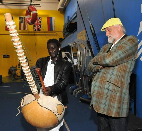 "Mick Fleetwood of Fleetwood Mac chats with one of ""O's"" band members, Toumany, about a possible future musical collaboration"