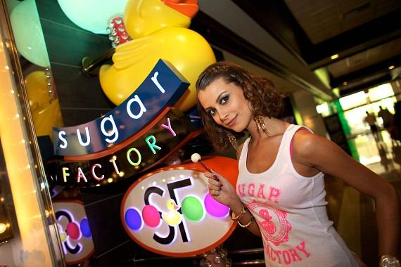 Miss Universe Stefania Fernandez poses in front of Sugar Factory at The Mirage with Miss Universe edition Couture Pop