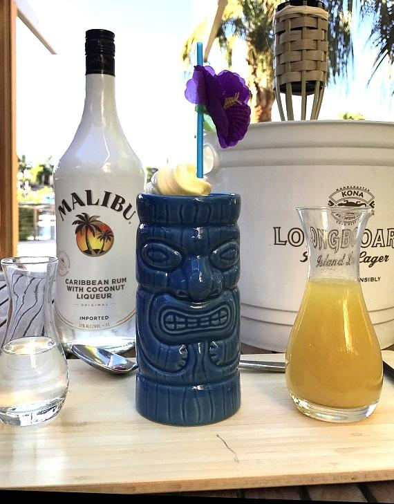 Pier Pressure Dole Whip made with Dole pineapple ice cream and topped with a choice of Malibu coconut and banana or mango and pineapple juice for $15