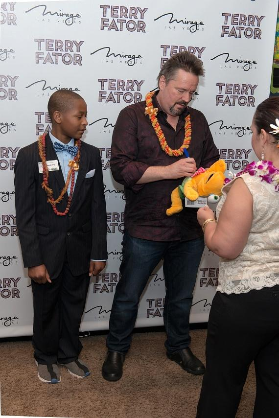 Terry Fator signs a Winston puppet for youth honoree TJ Stephens