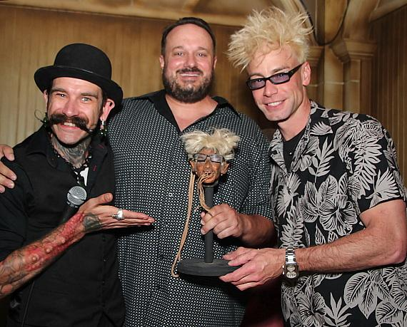The Baron of the Universe, Golden Tiki managing partner Branden Powers and Murray Sawchuck with Sawchuck's shrunken head
