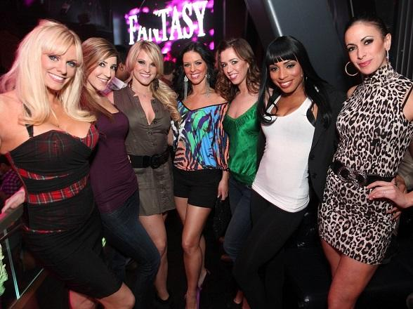 "The ladies of FANTASY pose in front of their LED ""FANTASY"" sing welcoming them to the nightclub"