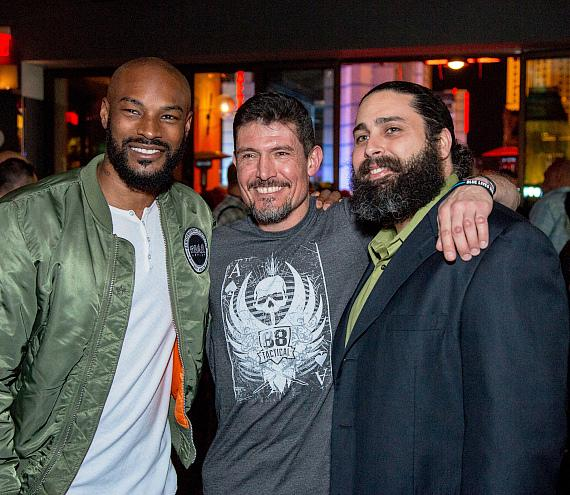 """Tyson Beckford and Kris """"Tanto"""" Paronto posing with fans at Hyde Bellagio during Outdoor Tradeshow after-party"""