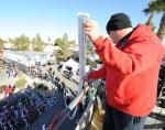 98.5 KLUC Morning Zoo Host Chet Buchanan holding the receipt that stretched more than 150 feet
