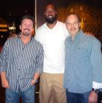 Former NBA player Chris Wilcox with Executives Richard Wilk and Steve Cyr