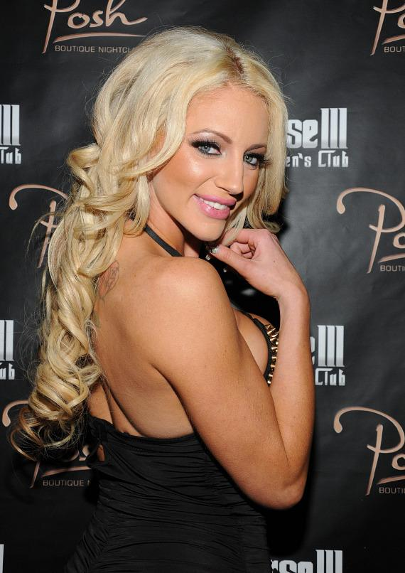 Nicolette Shea poses on the red carpet at Crazy Horse III's New Year's Eve bash