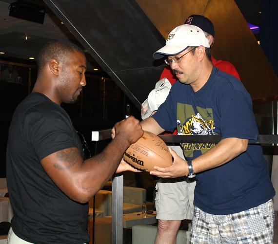 Shaun Phillips signing autographs for fans at The Sportsbook Bar & Grill at The Palazzo