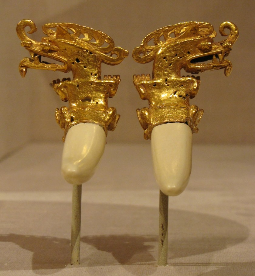 Double Pendant in the Form of a Mythical Caiman, gold with plaster restoration of boar tusks, 800/1200 CE, Coclé; Coclé province, Panama