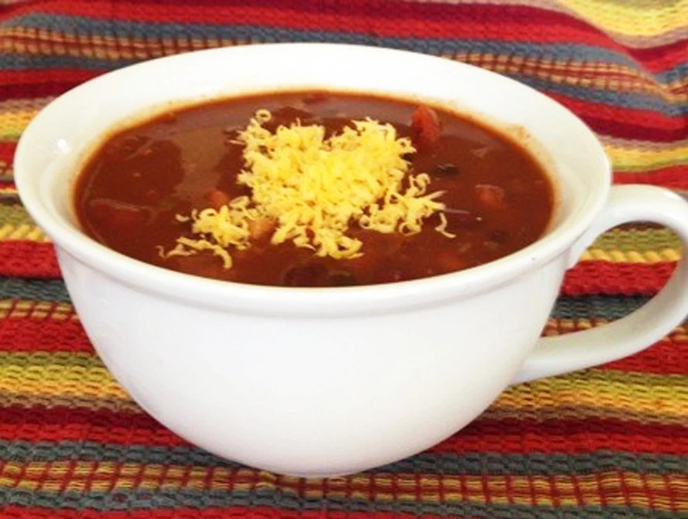vegetarian chili in a cup with cheese