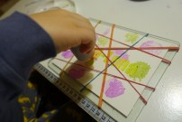 Gabriel painting the rubber band watercolor