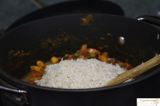 Rice and Cooked veggies with tomato just ready to be stirred in