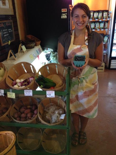 Megan holding fresh local blueberries