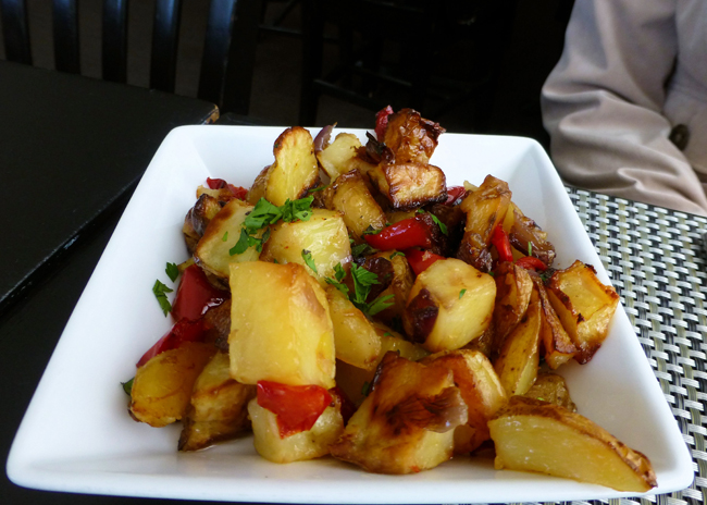 A separate side dish of home fries featured golden browned potatoes lightly tossed with olive oil, roasted red pepper, onion, and parsley ($2)
