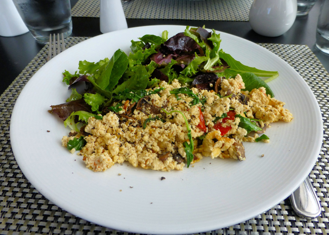 the tofu scramble was a delicious combination of finely chopped tofu, roasted button mushrooms, arugula, tomatoes, and herbes de provence ($10) complemented by a side of greens